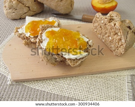 Wholemeal rolls with fruit jam - stock photo