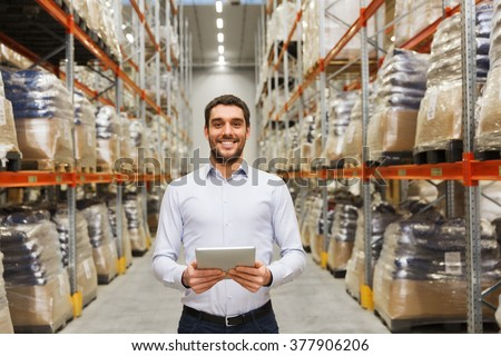 wholesale, logistic, business, export and people concept - happy man or manager with tablet pc computer at warehouse - stock photo