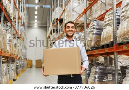wholesale, logistic, business, export and people concept - happy man with cardboard parcel box at warehouse - stock photo