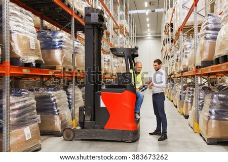 wholesale, logistic, loading, shipment and people concept - loader on forklift and businessman with tablet pc computer at warehouse - stock photo