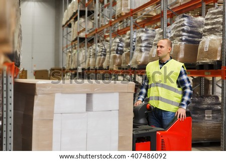 wholesale, logistic, loading, shipment and people concept - man or loader on forklift loading cargo at warehouse - stock photo