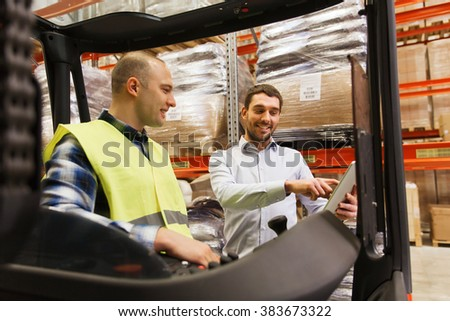 wholesale, logistic, loading, shipment and people concept - smiling loader on forklift and businessman with tablet pc computer at warehouse - stock photo