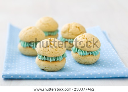Whoopie pies with turquoise cream frosting - stock photo