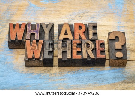 Why are we here? A philosophical and spiritual question in vintage letterpress wood type stained by color inks - stock photo