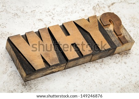 why question in vintage letterpress wood type on a ceramic tile background - stock photo