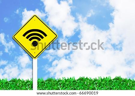 wi-fi wireless internet sign on beautiful sky and grass field background - stock photo