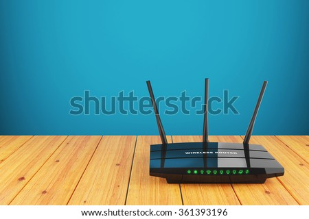 Wi-Fi wireless router on wooden table - stock photo