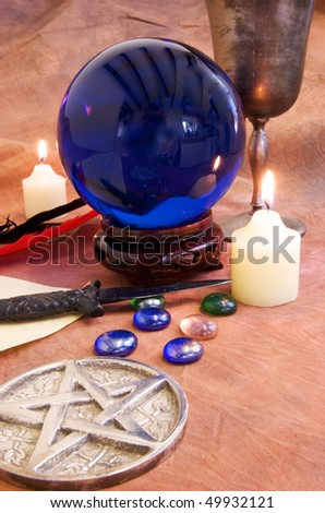 Wiccan and Witchcraft objects on a rustic brown background. - stock photo