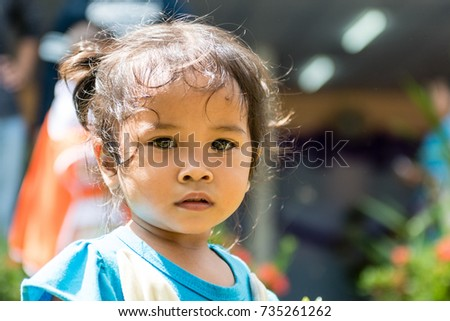 WICHIAN BURI, THAILAND - SEPTEMBER 27,2017: Small thai girl looking direction camera