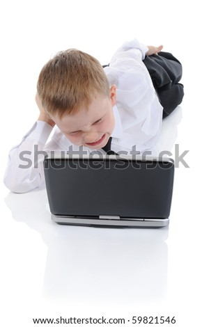 wicked boy lying on the floor with a laptop. Isolated on white background - stock photo