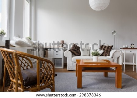 Wicker armchair in white stylish living room - stock photo