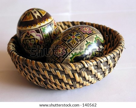 Wicker basket containing easter eggs
