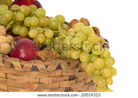 Wicker basket full of fruits on white background - stock photo