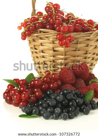 Wicker basket full of summer fruits, isolated background