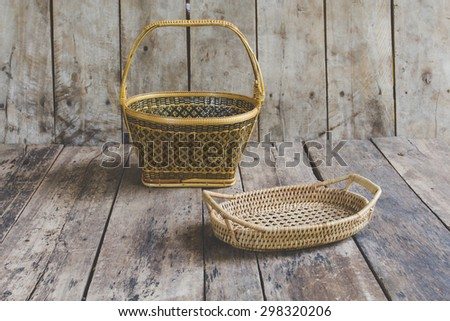 Wicker basket on the wooden floor.Wicker baskets, beautiful crafts of Thailand. - stock photo