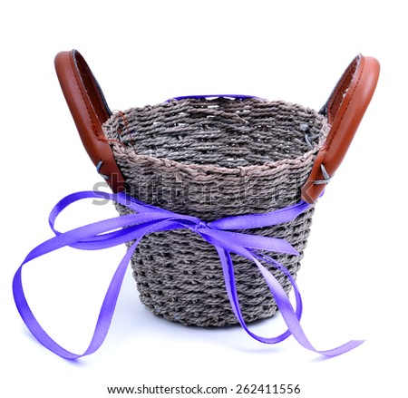 Wicker basket with a straw isolated on white - stock photo