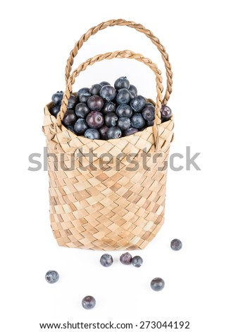 Wicker basket with Blueberries Isolate on white background - stock photo