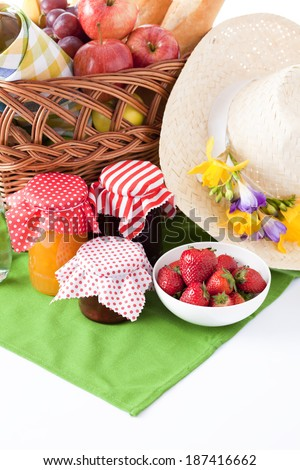 wicker basket with bread, cheese and wine  - stock photo