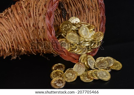 Wicker basket with currency spilling out/Gold Fortune/Money is spilling out of cornucopia - stock photo
