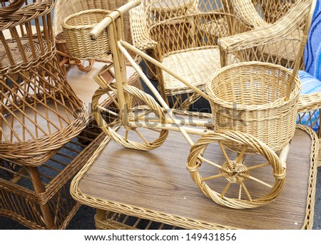 Wicker bicycle and furniture made from organic osier rod, on outdoor market  - stock photo