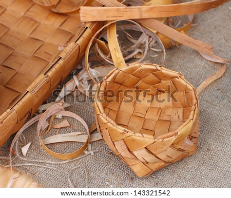 wicker bowl, made of birch bark and a pieces of birch bark - stock photo