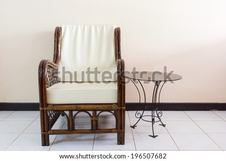 wicker chair in the morning light - stock photo