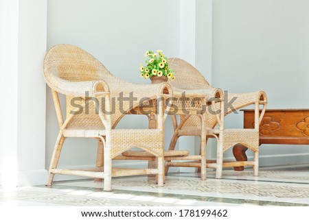 wicker chairs outdoor sunlight scene - stock photo