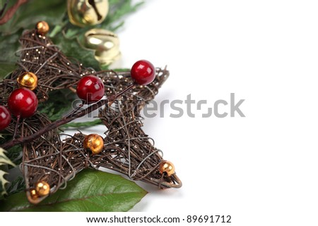 Wicker Christmas star and other Christmas decorations isolated on white. Shallow dof - stock photo