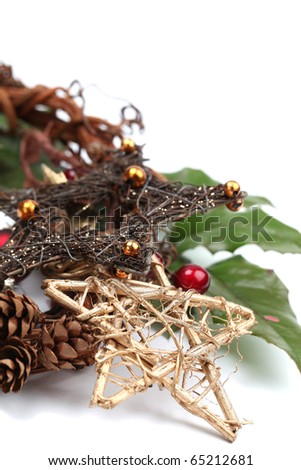 Wicker Christmas stars and other Christmas decorations isolated on white. Shallow dof - stock photo