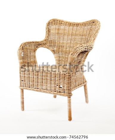 Wicker comfortable chair isolated on white background - stock photo