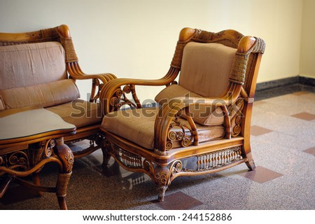 Wicker furniture chair in the interior. - stock photo