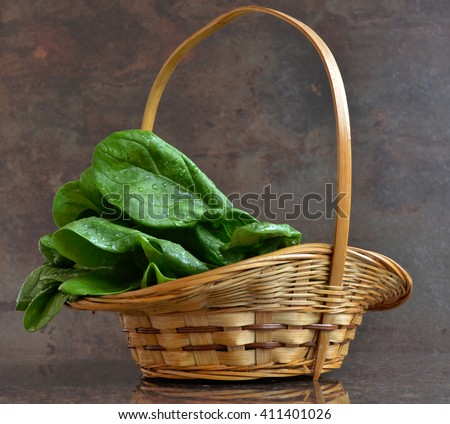 Wicker picnic basket with fresh spinach Diet and healthy food.  Products for weight loss, - stock photo