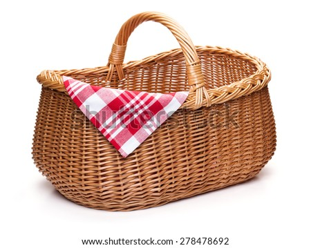 Wicker picnic basket with red checked napkin, isolated on the white background. - stock photo