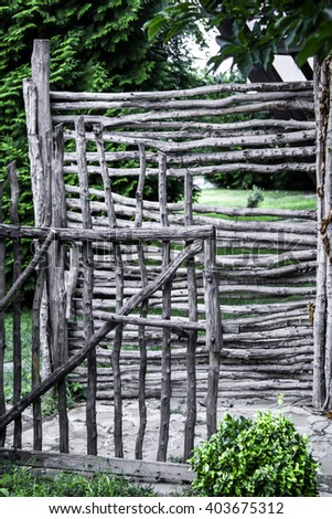 wicker rustic fence in the summer garden  - stock photo