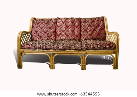 Wicker sofa with red cushion isolated on white background - stock photo