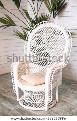 wicker white armchair in shabby chic interior - stock photo