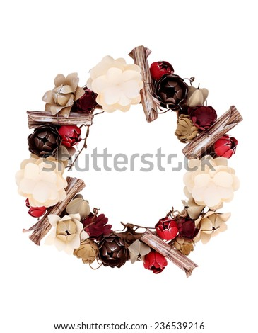wicker wreath decorated with handmade paper flower - stock photo