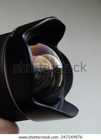 Wide angle camera lens with reflections closeup - stock photo