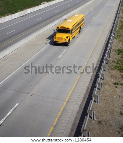 Wide Angle High shot of a Schoolbus with Copy Space Below - stock photo