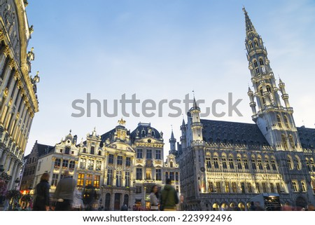 Wide angle night scene of the Grand Place, the focal point of Brussels, Belgium. The Town Hall (Hotel de Ville) is dominating the composition with its 96m tall spire - stock photo