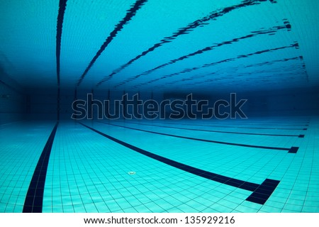 Wide angle of an empty swimming pool underwater / Empty Swimming Pool Underwater - stock photo