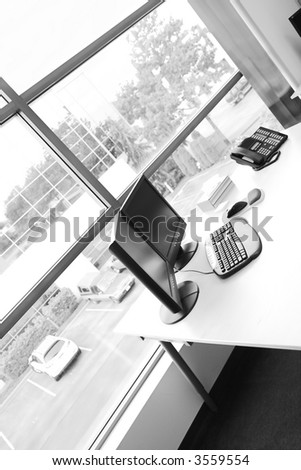 wide angle of office desk in black and white - stock photo