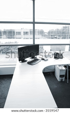 wide angle of office desk in blue tone - stock photo