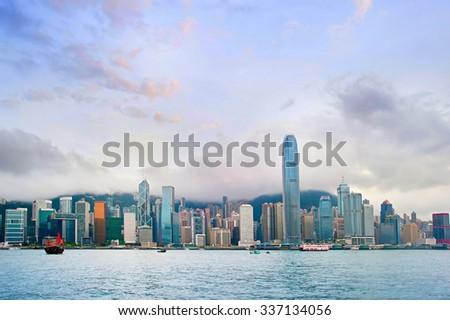 Wide angle panorama of Hong Kong at sunset - stock photo