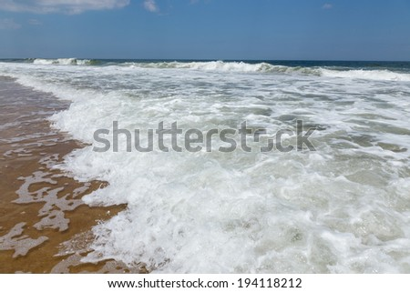 Wide angle personal view of the surf at the ocean shore