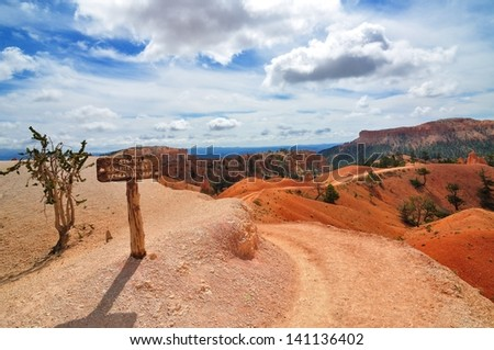 Wide angle photography of hiking trails in Bryce Canyon National Park with signpost - stock photo