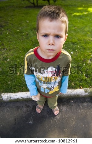 wide angle portrait of a kid with angry expression