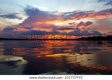 Wide angle scenic view of Laguna Grande, Cuyabeno National Park on sunset