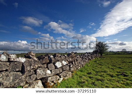 wide angle shot of a field in rural ireland - stock photo