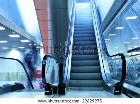 Wide angle shot of modern interior with escalator - stock photo